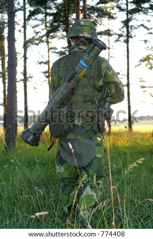 Soldier moving about in forest - stock photo