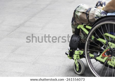 soldier on green  wheelchair - stock photo