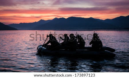 soldier on the boat in the river - stock photo
