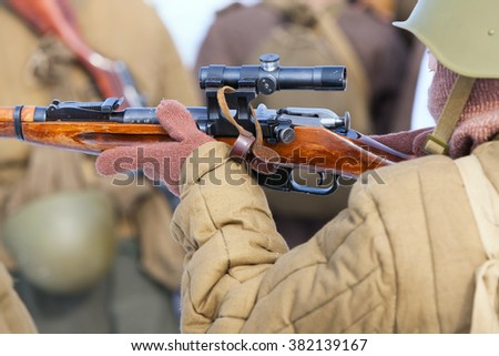 soldier or sniper hands holding gun  - stock photo