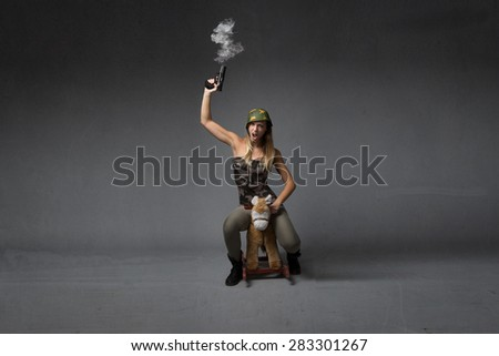 soldier riding horse with gun on hand - stock photo