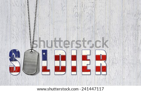 soldier's military dog tags with flag font on weathered wood background - stock photo