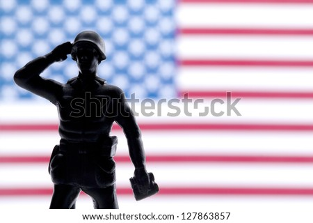 Soldier saluting and giving honor on his country - stock photo