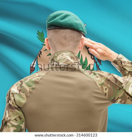 Soldier saluting to US state flag series - Oklahoma - stock photo