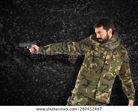 Soldier shooting a gun - stock photo