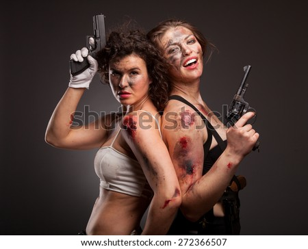 Soldier special tactics sexy girls holding up her weapon. With blood on face. Amazon girls.  - stock photo