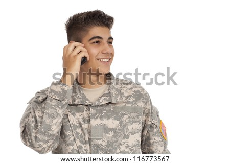 Soldier talking on cell phone - stock photo