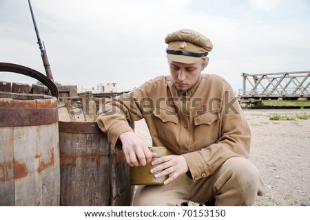 Soldier with a boiler in uniform of World War I. Costume accord the times of World War I. Photo made at cinema city Cinevilla in Latvia. Cockade on the hat do not contain trade mark. - stock photo