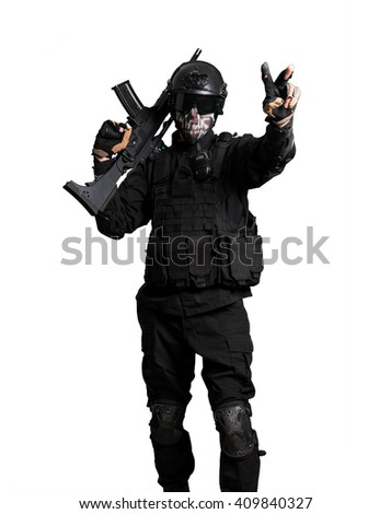 Soldier with a G36K doing victory gesture isolated - stock photo