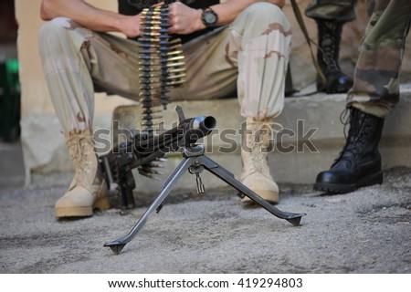soldier with a machine gun - stock photo