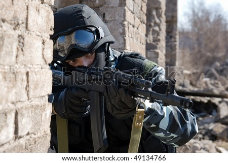Soldier with a rifle targeting - stock photo