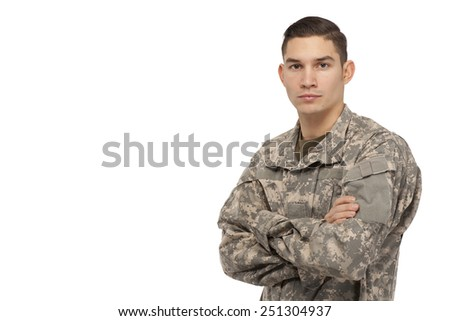 Soldier with arms crossed against white background - stock photo