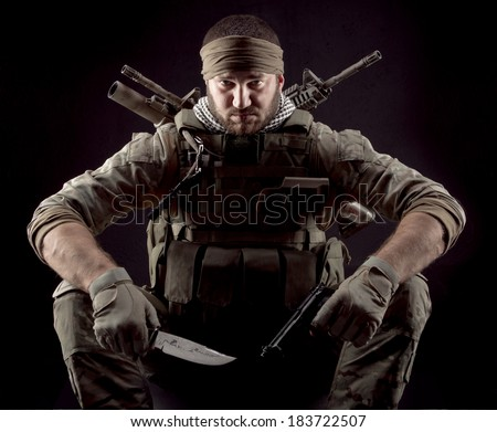 Soldier with gun and knife - stock photo