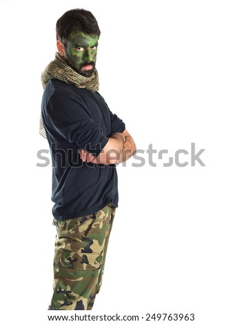 Soldier with his arms crossed  - stock photo