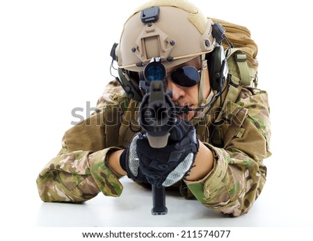 Soldier with rifle and lying on floor over white background - stock photo