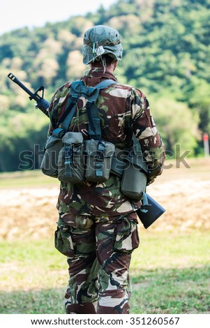 Soldier with rifle in hand - stock photo