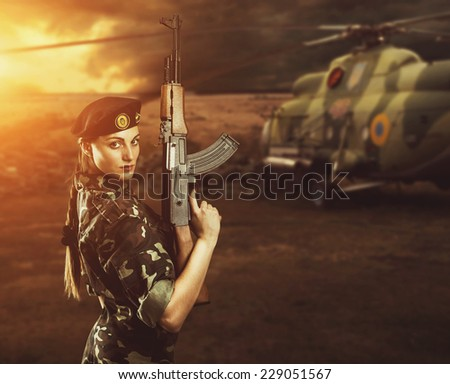 Soldier woman on the battle field - stock photo