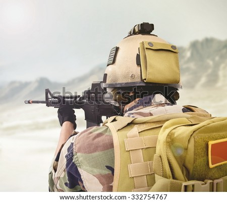 soldiers fighting in the desert - stock photo