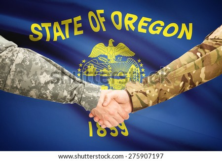 Soldiers handshake and US state flag - Oregon - stock photo