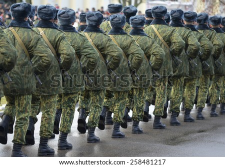 Soldiers in camouflage military uniform in rest position, standing - stock photo