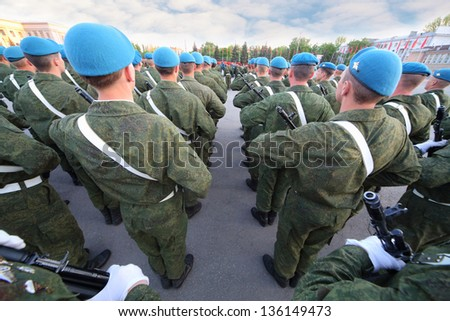 Soldiers with guns marching in the parade. - stock photo