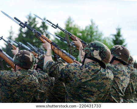 Soldiers with military camouflage uniform in army formation - stock photo