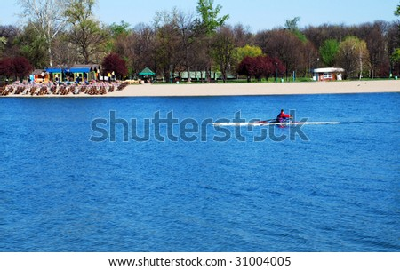 sole kayak over blue water at sunny spring morning - stock photo