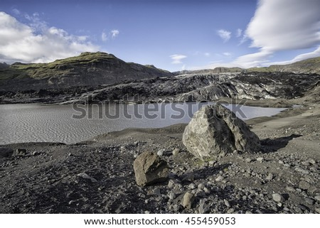 Solheimajokull outlet glacier in Iceland, photo taken in summer during a rather hot day in sunshine - stock photo