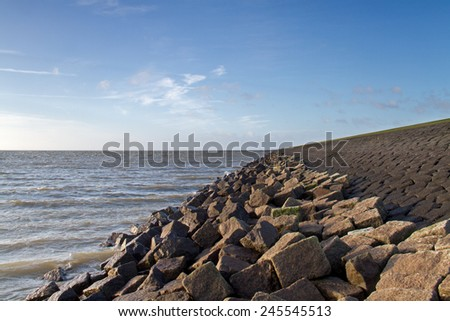 Solid dike of rocks and boulders - stock photo