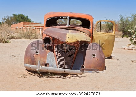 SOLITAIRE, NAMIBIA -  NOVEMBER 26, 2015: Old rusted car in front of the gas station Solitaire - stock photo