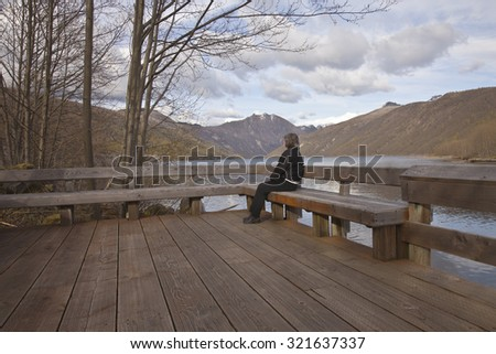 Solitude and reflections surrounded by nature with a view. - stock photo