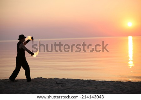 Solo fire show at sunset - stock photo