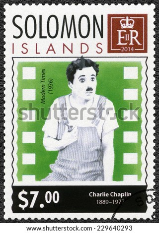 SOLOMON ISLANDS - CIRCA 2014: A stamp printed in Solomon Islands shows portrait of Charlie Chaplin (1889-1977), 125th anniversary of birthday, circa 2014 - stock photo