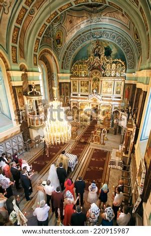 SOLOTVINO, UKRAINE - MAY 11, 2013: Church in Solotvino, Ukraine, May 2013, wedding ceremony. - stock photo