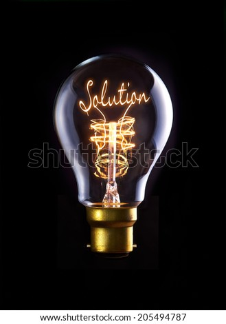 Solution concept in a filament lightbulb. - stock photo
