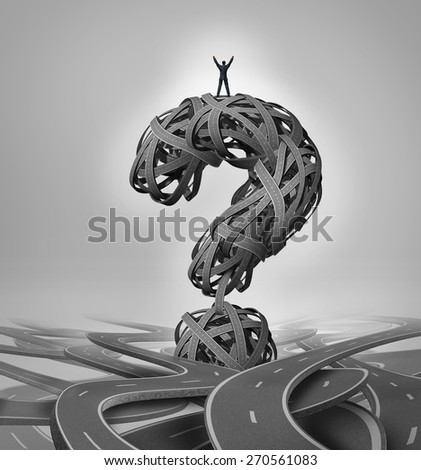 Solution road business concept as a businessman standing with arms raised in victory on a group of roads shaped as a question mark as a success metaphor. - stock photo