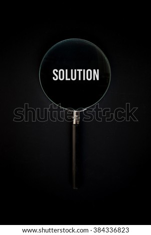 Solution, word in Magnifying glass - stock photo