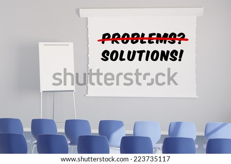 Solutions instead of problems on whiteboard in a business seminar room - stock photo