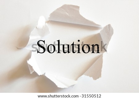 solving a business problem with solution in a paper hole - stock photo
