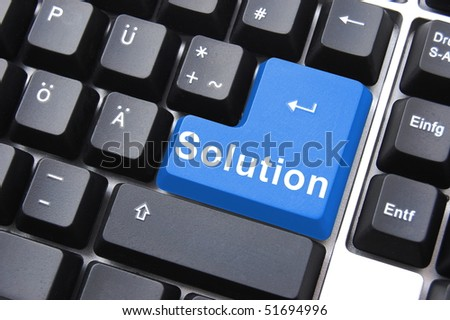 solving a problem with solution button on computer - stock photo