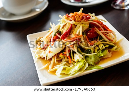 som tum, papaya spicy sweet and sour salad with raw crab and vegetable called Som tum - stock photo