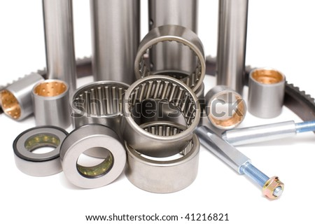 some auto spare parts against white background in shallow DOF - stock photo