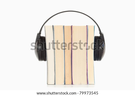 Some books and headphones against a white background - stock photo