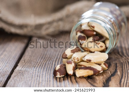 Some Brazil Nuts on vintage wooden background - stock photo