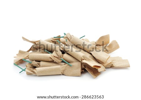 some brown firecrackers with green fuse on a white background - stock photo