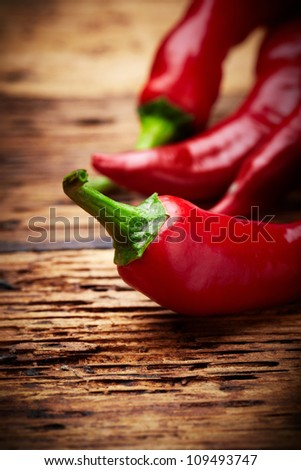 some chili peppers on a table - stock photo