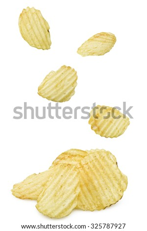 some chips falling on a white background - stock photo