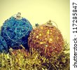 some christmas balls and golden tinsel with a retro effect - stock photo