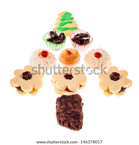 some christmas cookies arranged in a christmas tree shape over white - stock photo