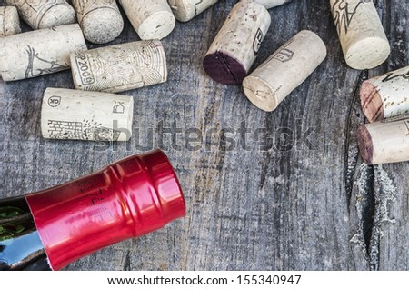 Some corks with a bottle - stock photo